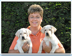Image: Picture of Debbie Leach and two beautiful puppies.
